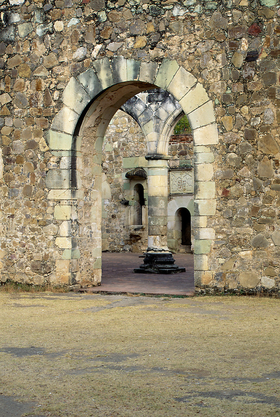 Cuilapan Monastery , column seen through arched stone doorway #7157. Oaxaca Mexico.
