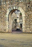 Cuilapan Monastery , column seen through arched stone doorway #7157. Oaxaca Mexico.