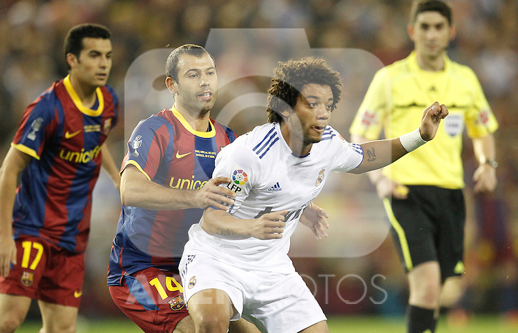 Real Madrid's Marcelo Vieira and FC Barcelona's Javier Mascherano during la Spain King's Cup Final match in Valencia, Spain on April 20th 2011...Photo: Cesar Cebolla / ALFAQUI