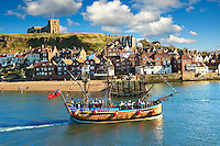 Tourists on a Pirate boat  in Whitby harbour. North Yorkshire, England