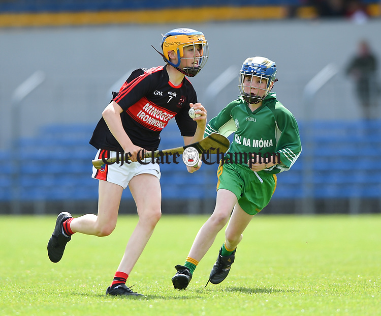 Mikey Bogenberger of Mountshannon/Lackyle  in action against James Hegarty of Kilnamona during their Schools Division 3 final at Cusack Park. Photograph by John Kelly