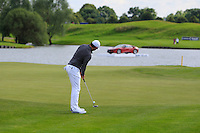 Rory McIlroy (NIR) on the 18th green during Round 2 of the 100th Open de France, played at Le Golf National, Guyancourt, Paris, France. 01/07/2016. <br /> Picture: Thos Caffrey | Golffile<br /> <br /> All photos usage must carry mandatory copyright credit   (&copy; Golffile | Thos Caffrey)