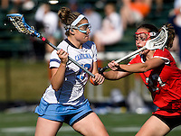 Becky Lynch (13) of North Carolina tries to get past Ali O'Neil (27) of Cornell at St. Stephens and St. Agnes High School in Alexandria, VA.  North Carolina defeated Cornell, 13-7.