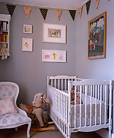 The elegant grey walls of this child's bedroom are decked with bunting