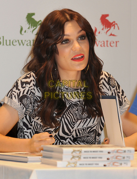 Jessie J (Jessica Ellen Cornish).signs copies of her autobiography 'Nice To Meet You' at Bluewater Shopping Centre, Kent, UK,.September 28th 2012..half length sitting black and white print top nails nail varnish polish .CAP/BK/PP.©Bob Kent/PP/Capital Pictures