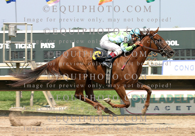 Redaspen, and jockey Victor Molina, run to victory in the $50,000 Foxy JG Stakes at Philadelphia Park.  6-25-05. Photo by Equi-Photo