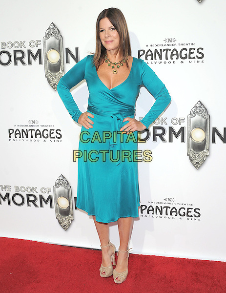 "Marcia Gay Harden.""The Book of Mormon"" Hollywood Opening night Held At The Pantages theatre, Hollywood, California, USA..September 12th, 2012.full length dress beige peep toe green blue turquoise hands on hips.CAP/DVS.©DVS/Capital Pictures."