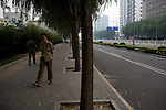Streets often look bare in the city as new traffic laws are in affect during the Olympics allowing odd and even license plates to drive on opposite days in Beijing, China on Monday, August 4, 2008. The city of Beijing is gearing up for the opening ceremonies of the Olympic Games.  Kevin German