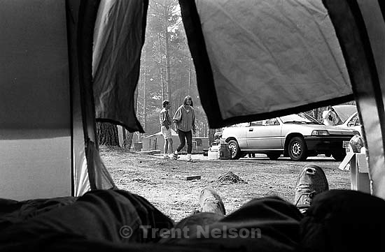 Trent feet and Tim Wilcox and Laura Nelson on campout.<br />