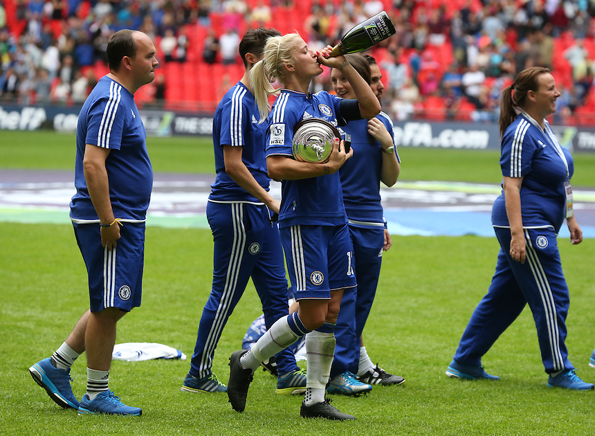 Chelsea's Katie Chapman ( M ) with Trophy<br /> <br /> Photographer Kieran Galvin/CameraSport<br /> <br /> Women's Football - The SSE Women's FA Cup Final - Notts County Ladies v Chelsea Ladies - Saturday 01 August 2015 - Wembley - London<br /> <br /> &copy; CameraSport - 43 Linden Ave. Countesthorpe. Leicester. England. LE8 5PG - Tel: +44 (0) 116 277 4147 - admin@camerasport.com - www.camerasport.com