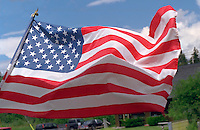 United States flag blowing in the wind. Cedarville Michigan USA