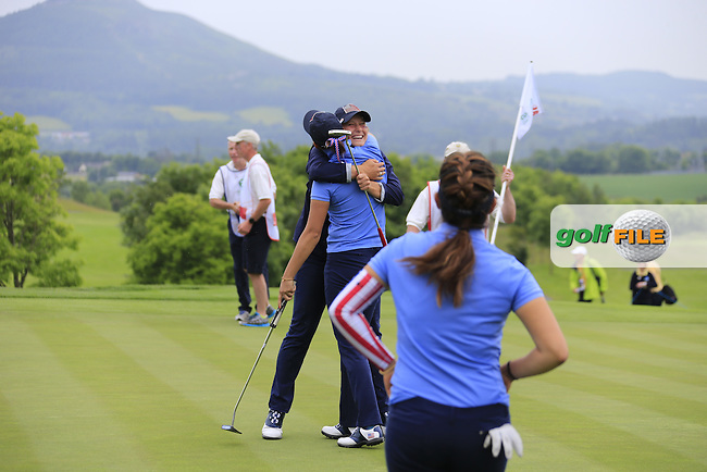 Monica Vaughn celebrates with Bailey Tardy on the 18th during the Friday morning foursomes at the 2016 Curtis cup from Dun Laoghaire Golf Club, Ballyman Rd, Enniskerry, Co. Wicklow, Ireland. 10/06/2016.<br /> Picture Fran Caffrey / Golffile.ie<br /> <br /> All photo usage must carry mandatory copyright credit (&copy; Golffile | Fran Caffrey)
