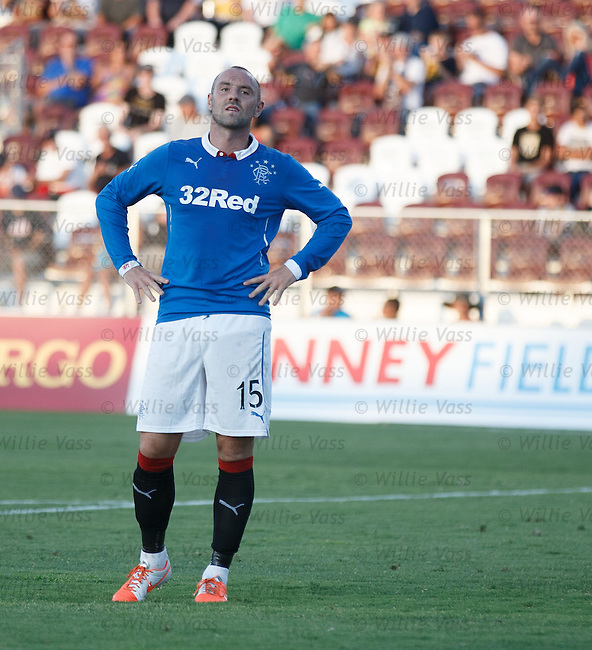 Kris Boyd stands dejected after missing