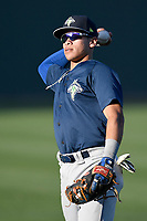 Shortstop Edgardo Fermin (10) of the Columbia Fireflies warms up before a game against the Greenville Drive on Tuesday, April 17, 2018, at Fluor Field at the West End in Greenville, South Carolina. Columbia won, 7-5. (Tom Priddy/Four Seam Images)