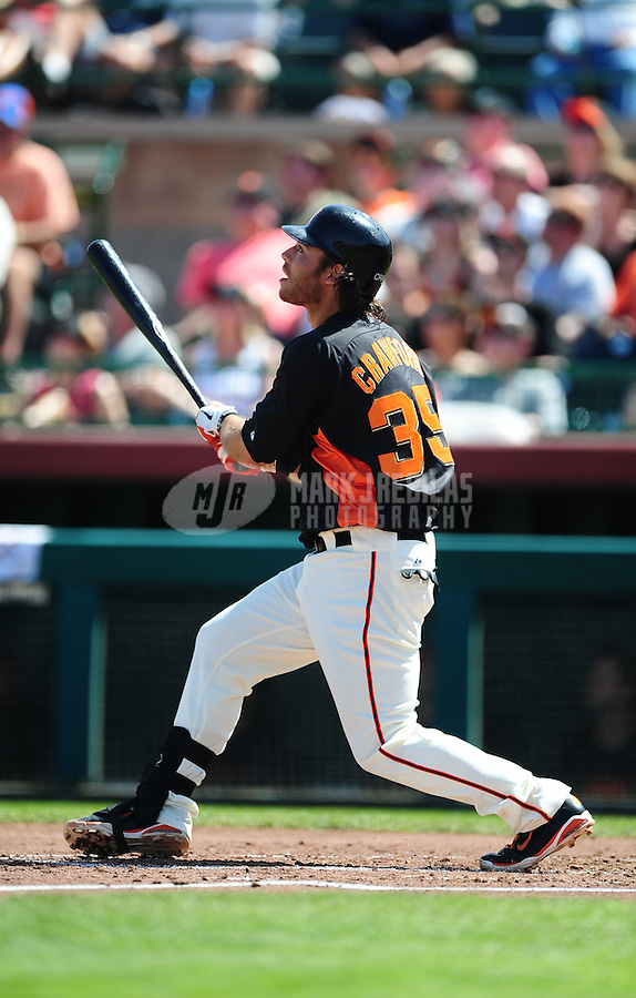 Mar. 28, 2012; Scottsdale, AZ, USA; San Francisco Giants shortstop Brandon Crawford hits a solo home run in the second inning against the Los Angeles Dodgers at Scottsdale Stadium.  Mandatory Credit: Mark J. Rebilas-