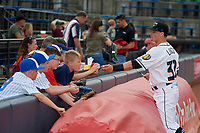 Akron RubberDucks Mitch Longo (30) signs autographs before an Eastern League game against the Reading Fightin Phils on June 4, 2019 at Canal Park in Akron, Ohio.  Akron defeated Reading 8-5.  (Mike Janes/Four Seam Images)