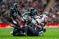 3rd November 2019; Wembley Stadium, London, England; National Football League, Houston Texans versus Jacksonville Jaguars; Running Back Carlos Hyde of Houston Texans is tackled - Editorial Use