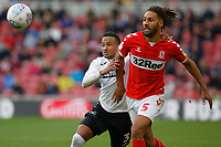 (L-R) Martin Olsson of Swansea City challenges Ryan Shotton of Middlesbrough during the Sky Bet Championship match between Middlesbrough and Swansea City at the Riverside Stadium, Middlesbrough, England, UK. Saturday 22 September 2018