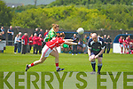Referee Jason Mullins from Limerick with eyes in the back of his head ducks low as Kerrys Laura Rogers has enough space to get this one past the challenges of Corks Ann Marie Walsh in the Munster Ladies Senior Round 1 clash at the Con Keating Park in Cahersiveen on Sunday.
