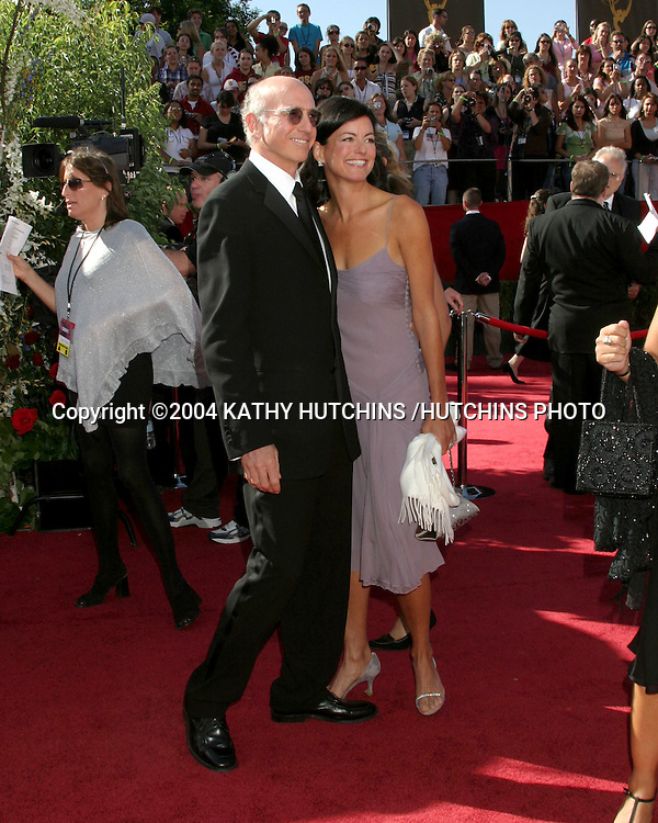 ©2004 KATHY HUTCHINS /HUTCHINS PHOTO.56TH ANNUAL PRIMETIME EMMY'S.SHRINE AUDITORIUM.LOS ANGELES, CA.SEPTEMBER 19, 2004..LARRY DAVID AND WIFE