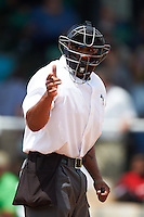 Umpire J.J. January makes a call during the 20th Annual Rickwood Classic Game between the Jacksonville Suns and Birmingham Barons on May 27, 2015 at Rickwood Field in Birmingham, Alabama.  Jacksonville defeated Birmingham by the score of 8-2 at the countries oldest ballpark, Rickwood opened in 1910 and has been most notably the home of the Birmingham Barons of the Southern League and Birmingham Black Barons of the Negro League.  (Mike Janes/Four Seam Images)