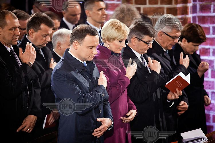 On the 1050 anniversary of the Polish adoption of Catholicism (the Baptism of Poland), Polish President Andrzej Duda and his wife Agata Korhauzer-Duda pray during mass at the Gniezno Cathedral.