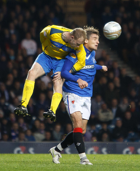 Steven Anderson makes a clearance from Rangers striker Nikica Jelavic