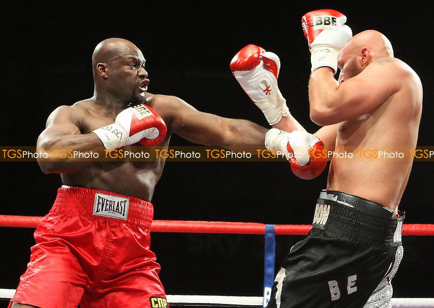 Larry Olubamiwo (red) defeats Dave Ferguson in a Heavyweight boxing contest at the Brentwood Centre, Essex, promoted by Frank Maloney / FTM Sports -  25/06/10 - MANDATORY CREDIT: Gavin Ellis/TGSPHOTO - Self billing applies where appropriate - Tel: 0845 094 6026