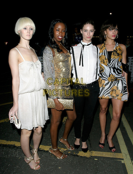 JASMIA - BRITAIN'S NEXT TOP MODEL.MOBO Awards 2006, Royal Albert Hall, London, UK.September 20th, 2006.Ref: AH.Mobos full length hite balck yellow floral print dress contestants gold dress.www.capitalpictures.com.sales@capitalpictures.com.©Adam Houghton/Capital Pictures.