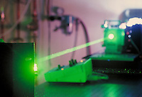 Green laser light beam and equipment in laboratory, California. Technology. California.