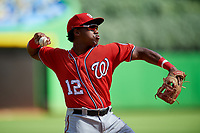 Washington Nationals Omar Meregildo (12) throws to first base during a Florida Instructional League game against the Miami Marlins on September 26, 2018 at the Marlins Park in Miami, Florida.  (Mike Janes/Four Seam Images)