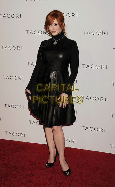 "Christina Hendricks.The Tacori Productions New ""City Lights"" Fall/Winter 2012 Collection Launch Party at The Lot Studio in West Hollywood, California, USA..October 9, 2012.full length black leather dress high collar turtleneck polo neck clutch bag gold cap toe shoes .CAP/ROT/TM.©Tony Michaels/Roth Stock/Capital Pictures"