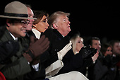 United States President Donald J. Trump and first lady Melania Trump Interior Secretary Ryan Zinke and Director of the National Park ServiceDavid Vela, left, participate in the Lighting Ceremony during the 2018 National Christmas Tree Lighting Ceremony at the Ellipse near the White House on November 28, 2018 in Washington, DC.<br /> Credit: Oliver Contreras / Pool via CNP