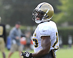 Running Back Reggie Bush flashes a smile during New Orleans Saints training camp.