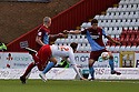 Niall Canavan of Scunthorpe clears a header from Robin Shroot of Stevenage .  Stevenage v Scunthorpe United - npower League 1 -  Lamex Stadium, Stevenage - 6th October, 2012. © Kevin Coleman 2012