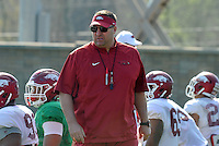 NWA Democrat-Gazette/Michael Woods --03/31/2015--w@NWAMICHAELW... University of Arkansas football coach Bret Bielema  works with the team during Tuesday afternoons practice in Fayetteville.