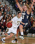 SPEARFISH, SD - DECEMBER 3, 2015 -- Julia Seamans #3 of Black Hills State drives around Megan Rohrer #33 of South Dakota Mines during their college basketball game Saturday at the Donald E. Young Center in Spearfish, S.D. (Photo by Dick Carlson/Inertia)