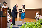 Seth Sharr congratulates Alejandra Martinez on her Scholarship from Gallery Furniture at the 2011 Aldine Scholarship Foundation Scholarship Ceremony at Lone Star College - North Harris