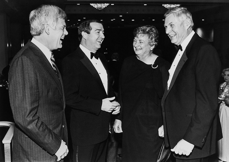 Rep. Jim McDermott, D-Wash., Rep. Greg Laughlin, D-Tex., and Rep. George E. Sangmeister, D-Ill., with his wife Doris Sangmeister, on Dec. 18, 1988. (Photo by Andrea Mohin/CQ Roll Call)
