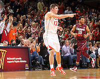 The crowd reacts as Virginia guard Joe Harris (12) puts in another 3-point basket during the game Tuesday in Charlottesville, VA. Virginia defeated Virginia Tech73-55.