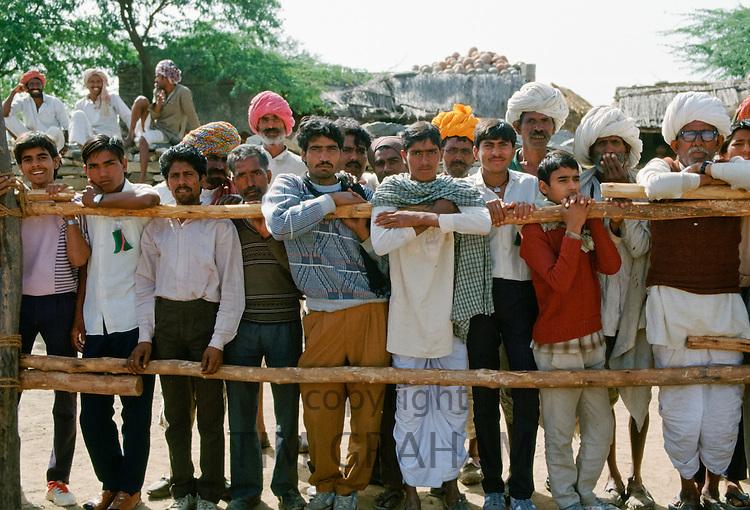 Group of Indian men watching festivities