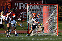 Lauren Benner (27) of Virginia makes a save during the first round of the ACC Women's Lacrosse Championship in College Park, MD.  Virginia defeated Virginia Tech, 18-6.