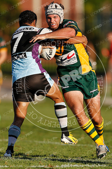 Nathan Clarke of the Wyong Roos is tackled by Panani Manumalealii of the Cronulla Sharks during Round 5 of the 2013 NSW Cup at Morrie Breen Oval on April 7, 2013 in Wyong, Australia. (Photo by Paul Barkley/LookPro)