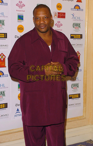 ALEXANDER O'NEAL.Sony Entertainment Television Asian Sports Personality Of The Year Awards, HIlton Park Lane Hotel, .London, England, February 4th 2006..half length red burgundy shirt trousers matching.Ref: CAN.www.capitalpictures.com.sales@capitalpictures.com.©Capital Pictures