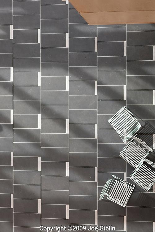 Tile floor  and random metal chairs on the campus of the University of Rhode Island. (Photo/Joe Giblin)