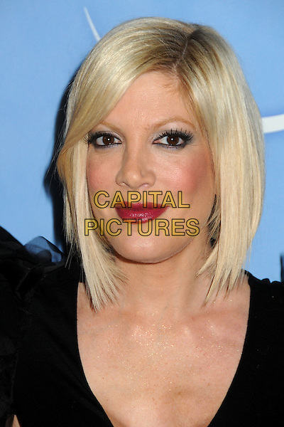 TORI SPELLING .NBC Universal Press Tour All-Star Party held at the Langham Huntington Hotel and Spa, Pasadena, California, USA, 13th January 2011..portrait headshot red lipstick make-up black .CAP/ADM/BP.©Byron Purvis/AdMedia/Capital Pictures.