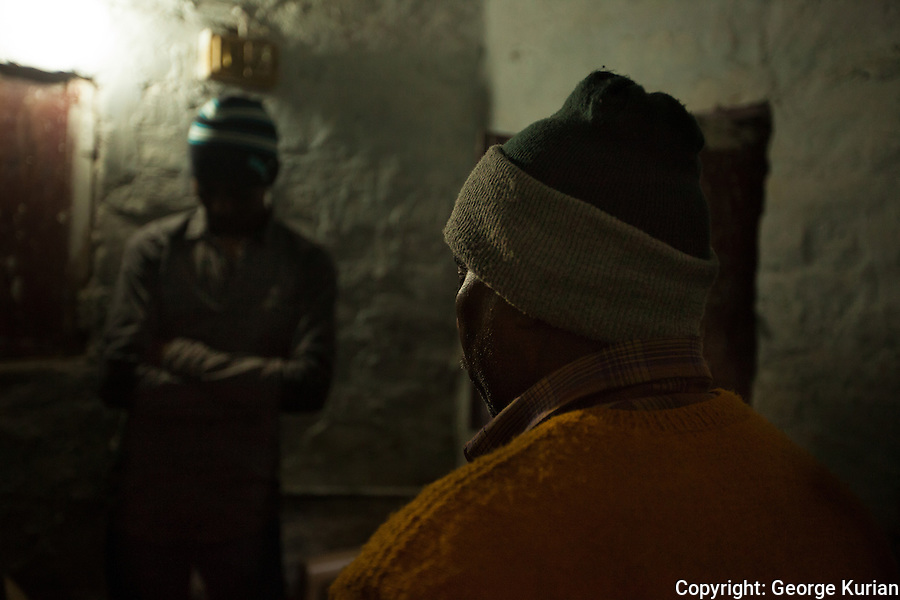 The brother and father of Jyothi, the murdered gang rape victim in their house in Delhi.