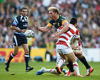 Schalk Burger of South Africa loses the ball after being double-tackled by Luke Thompson and Fumiaki Tanaka of Japan. Rugby World Cup Pool B match between South Africa and Japan on September 19, 2015 at the Brighton Community Stadium in Brighton, England. Photo by: Patrick Khachfe / Onside Images