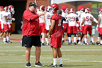 NWA Democrat-Gazette/DAVID GOTTSCHALK Bret Bielema, head coach of the Arkansas Razorbacks speaks with punter Blake Johnson Friday, July 18, 2017, during practice on campus in Fayetteville.