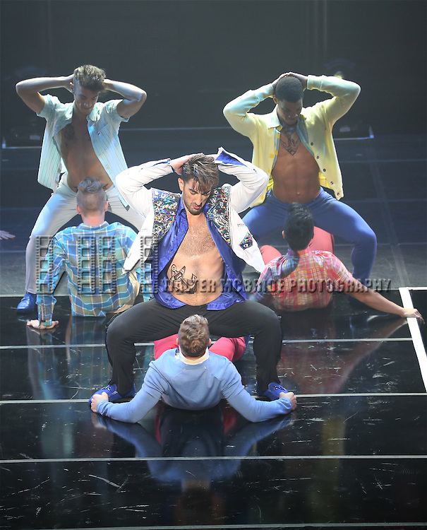 """Brandon Rubendall and cast perform in Broadway Cares/Equity Fights AIDS' """"Broadway Bares, Rock Hard!"""" at Hammerstein Ballroom June 22, 2014 in New York City."""